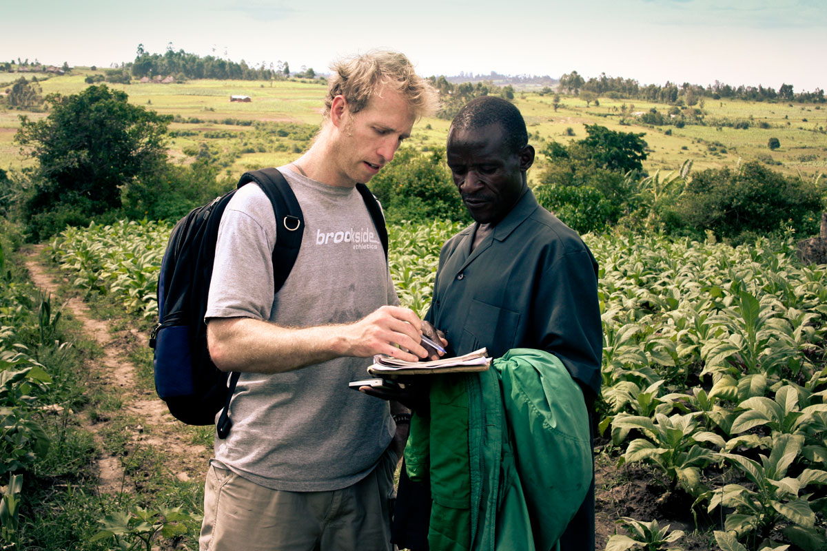 Jake Harriman talking with Agriculture Program Field Manager James Magaigwa Chacha in Kenya (Nuru International)